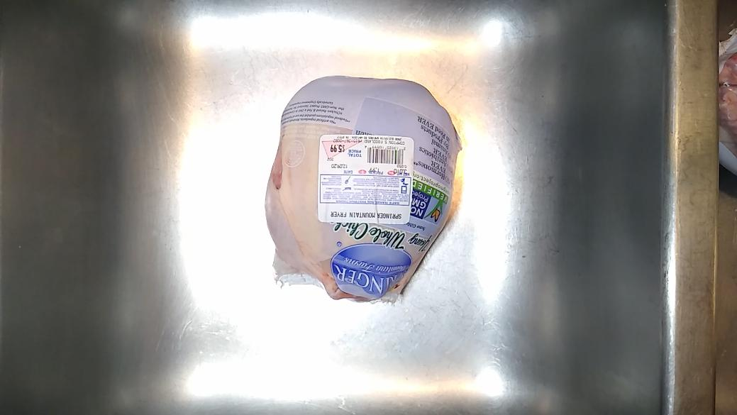 Whole chicken in package.