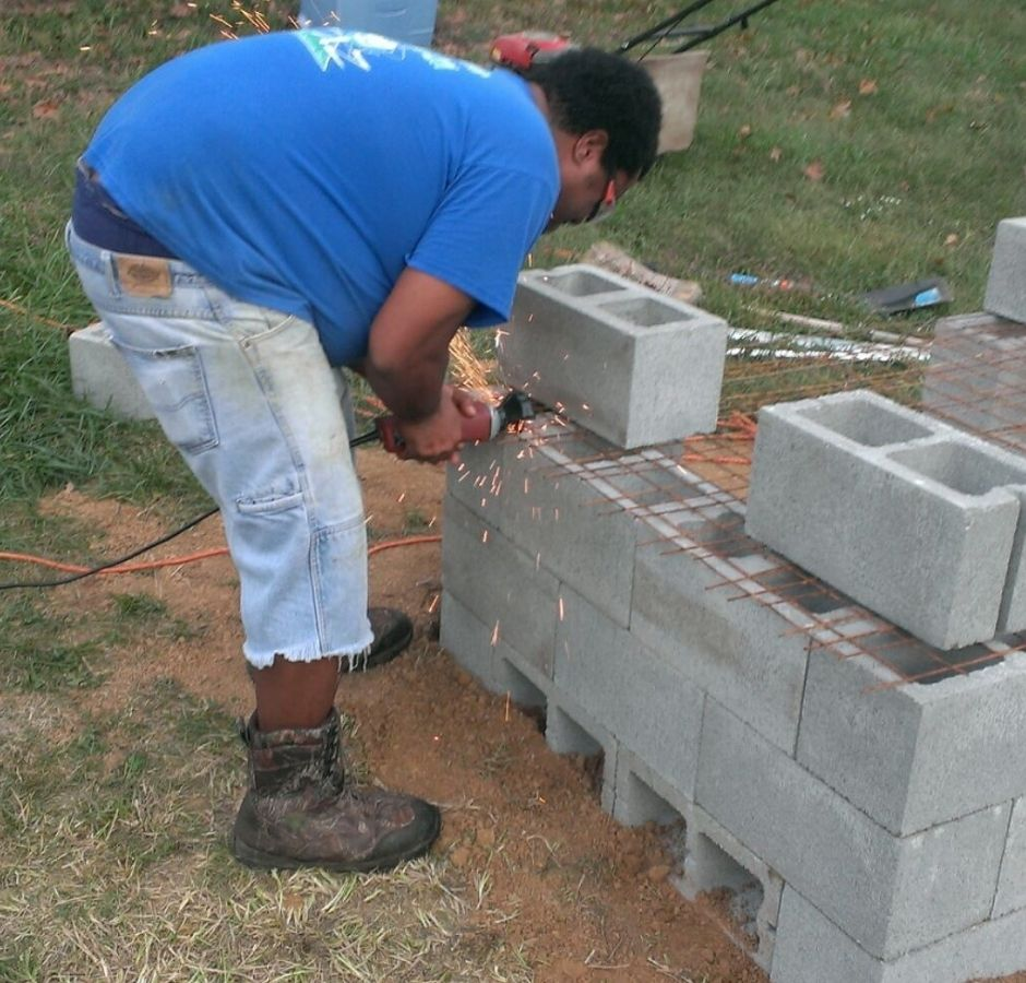How to Build a Cinder Block Smoker Uncle Bird cutting the cooking grate.